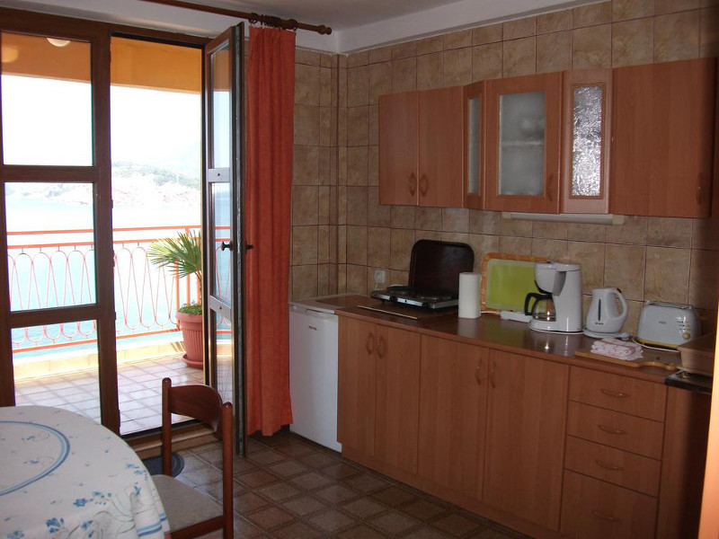 This is the big kitchen of the apartment number 3 with a terrace in front. Kitchen is eqipped basically.