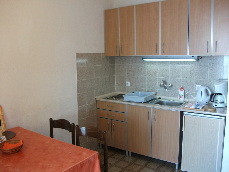 This is the kitchen of this apartment located on the second floor. Kitchen is equipped basically.