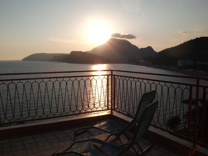 This is the sunset view from the terrace in front of the kitchen of the apartment no. 4 of the MONTERAMA apartment house in the second floor.